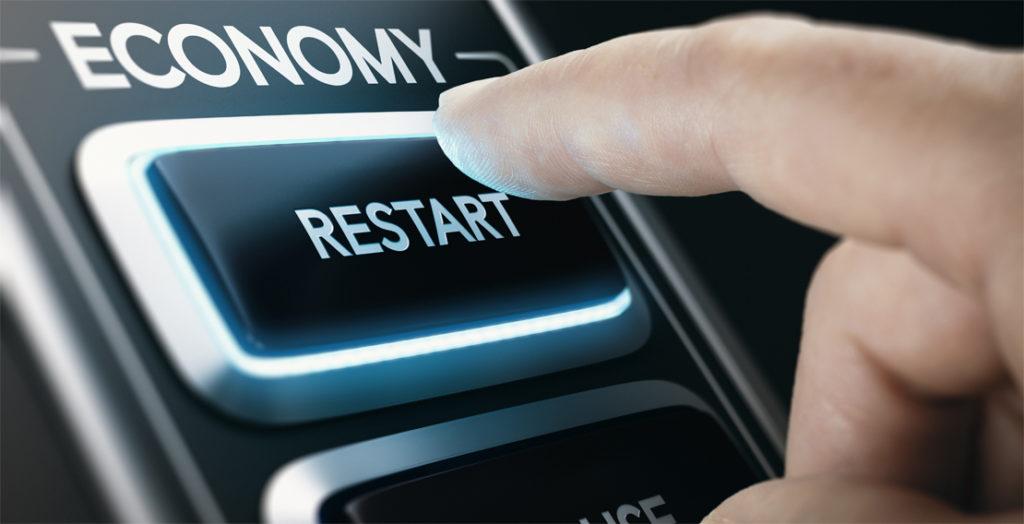 Finger drückt auf Restart-Button unter der Überschrift Economy